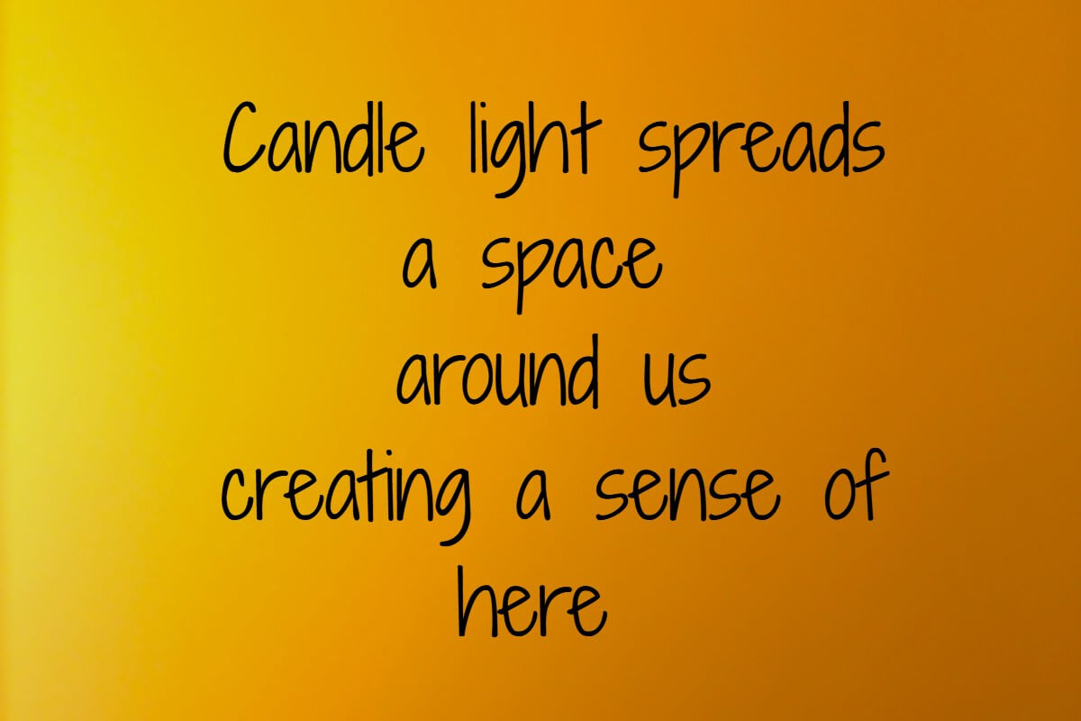 candle light spreads a space around us creating a sense of here